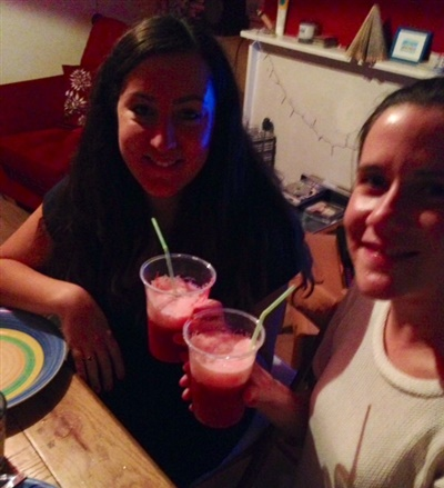 A photo of Sarah and Abi drinking a strawberry and beetroot cocktail