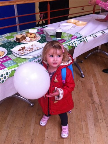 An image of Poppy and a Macmillan balloon