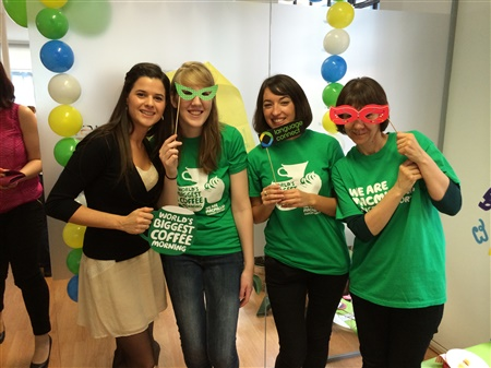 An image of some of the cancer info team wearing masks at the coffee morning