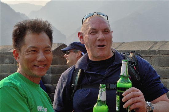 Photograph of two guides drinking beer at the top of the Wall