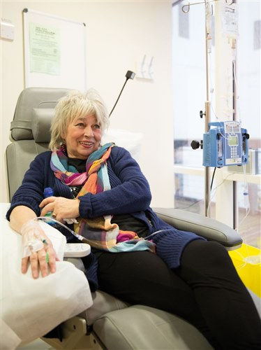 Photograph showing a lady having chemotherapy