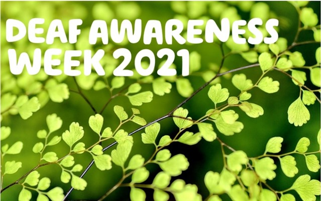 Deaf awareness week 2021 written in write over a photo of lots of small green leaves.