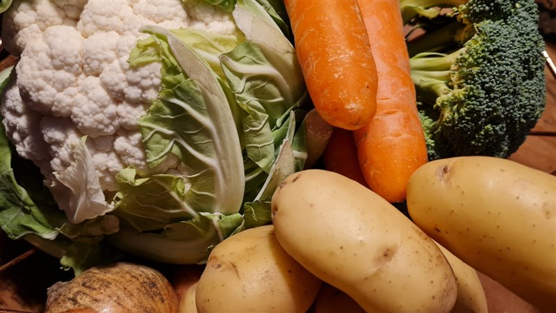 A close up image of fresh whole vegetables
